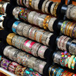 Foto de Stock  : Rows of colorful bracelets on jewelry market