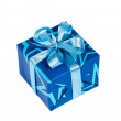 Gift box tied with blue ribbon - Stock Photo