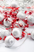 Christmas silver balls and red stars — Stock Photo