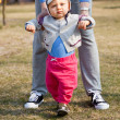 Mother helping son learn to walk — Stock Photo