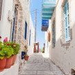 Narrow street in greek style — Stock Photo