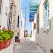Narrow street in greek style - Stock Photo