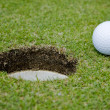 Golf ball very close to a hole — Stock Photo #7300697