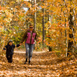 Mother and son in autumn forest — Stock Photo