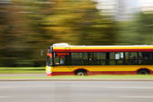 City bus in motion blur — Stock Photo