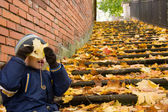Small boy goofing around in autumn scenery — Stock Photo
