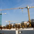 Cranes on construction site — Stock Photo #7677453