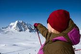 Woman pointing mountains — Stock Photo
