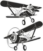 Vector retro biplane — Stockvector