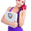 Girl with scales and apple — Stock Photo #6755066