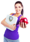 Girl with scales and apple — Stock Photo