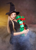 Witch with presents — Stock Photo