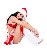Girl dressed as Santa — Stockfoto