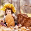 Baby with a loaf — Stock Photo