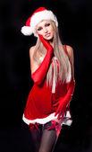 Woman dressed as Santa — Stock Photo