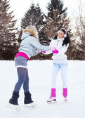 Girls ice skating — Stock Photo