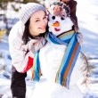 Woman with a snowman — Stock Photo