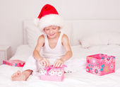 Child opening presents — Stock Photo