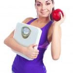 スケールとりんごを持つ女性 — ストック写真