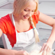 Woman baking - Stock Photo