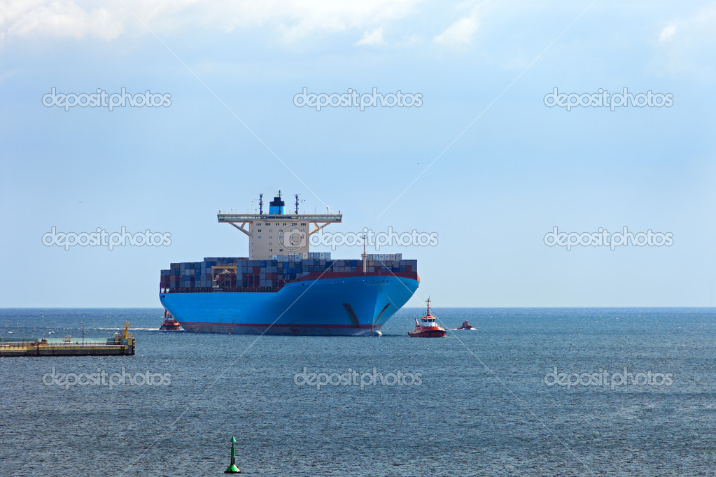 Container Ship is one of the largest container ships in the world. The length of the ship is 398m, width 56m, taking on board the 15 000 containers.   Stock Photo #6803096