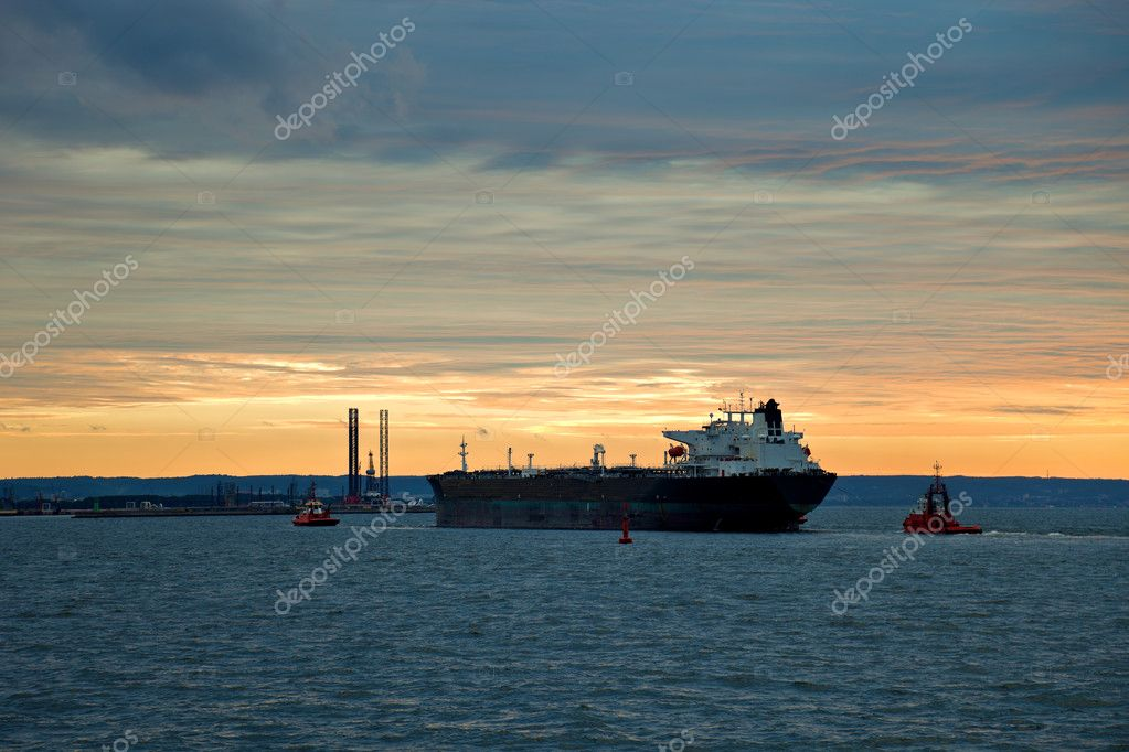 Maneuvering a large oil tanker at sea.   Stock Photo #6837228