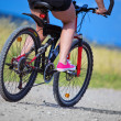 Active woman on a bike — Stock Photo