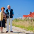 Happy senior couple and house — Stock Photo #7147922