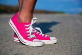 Pink sneakers on girl, woman legs — Stock Photo