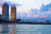 Barcelona skyline from sea — Stock Photo