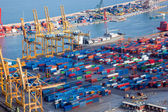 Harbor with lots of cargo — Stock Photo