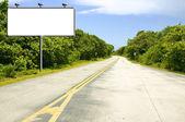 Billboard on road — Stock Photo