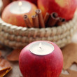 Apple as candlestick — Stockfoto
