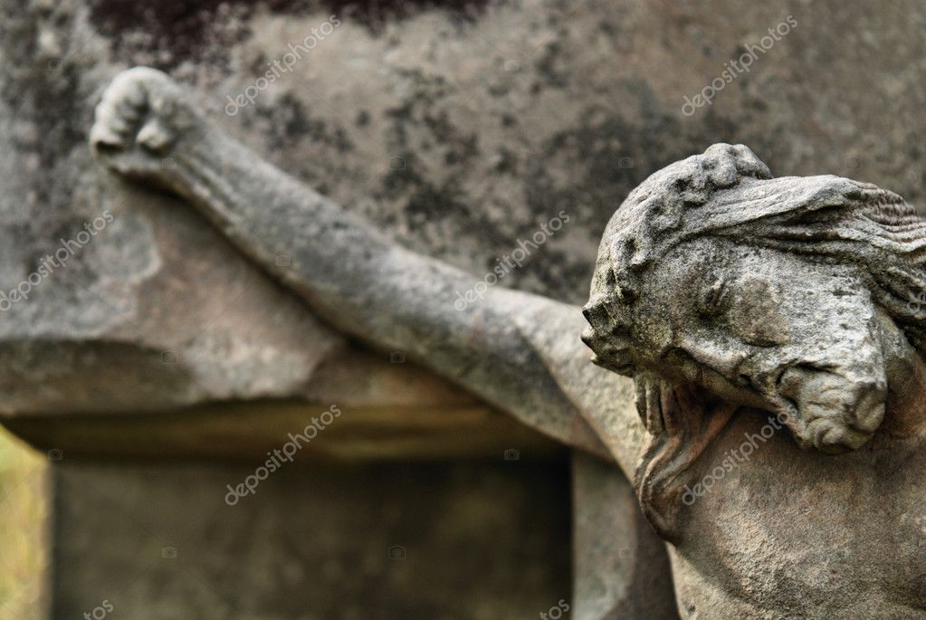 Face of Jesus, old statue in cemetery  Stock Photo #7645233