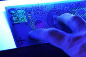 100 pln polish banknote in ultraviolet light — Stok fotoğraf