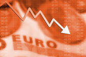 Arrow graph going down and euro currency in background — Stock Photo
