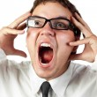 Young office worker in glasses mad by stress screaming isolated on white — Stock Photo