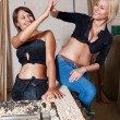 Sexy girls in the carpentry shop carpenters — Stock Photo