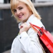 Beautiful young girl with a shopping Bag — Stock Photo