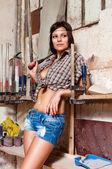 Portrait sexy girl in the carpentry shop carpenters — Stock Photo