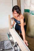 Beautiful girl working in the carpentry shop — Stock Photo