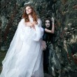 Stock Photo: Witch and angel against the walls of the old castle