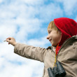 The boy drawing a chalk on cloudy sky — Stock Photo