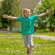 Little boy running in park — Stock Photo