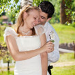 Bride and groom in park — Stock Photo #7314834