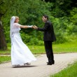 Royalty-Free Stock Photo: Dancing wedding couple at a park on a sunny day