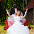 Young wedding couple outdoors on their wedding day — Stock Photo