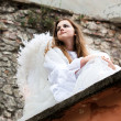 Angel sitting on a roof of the old castle — Stock Photo