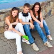 Royalty-Free Stock Photo: Small group of students sitting on street