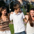 Portrait of three happy young teenagers — Stock Photo #7315022